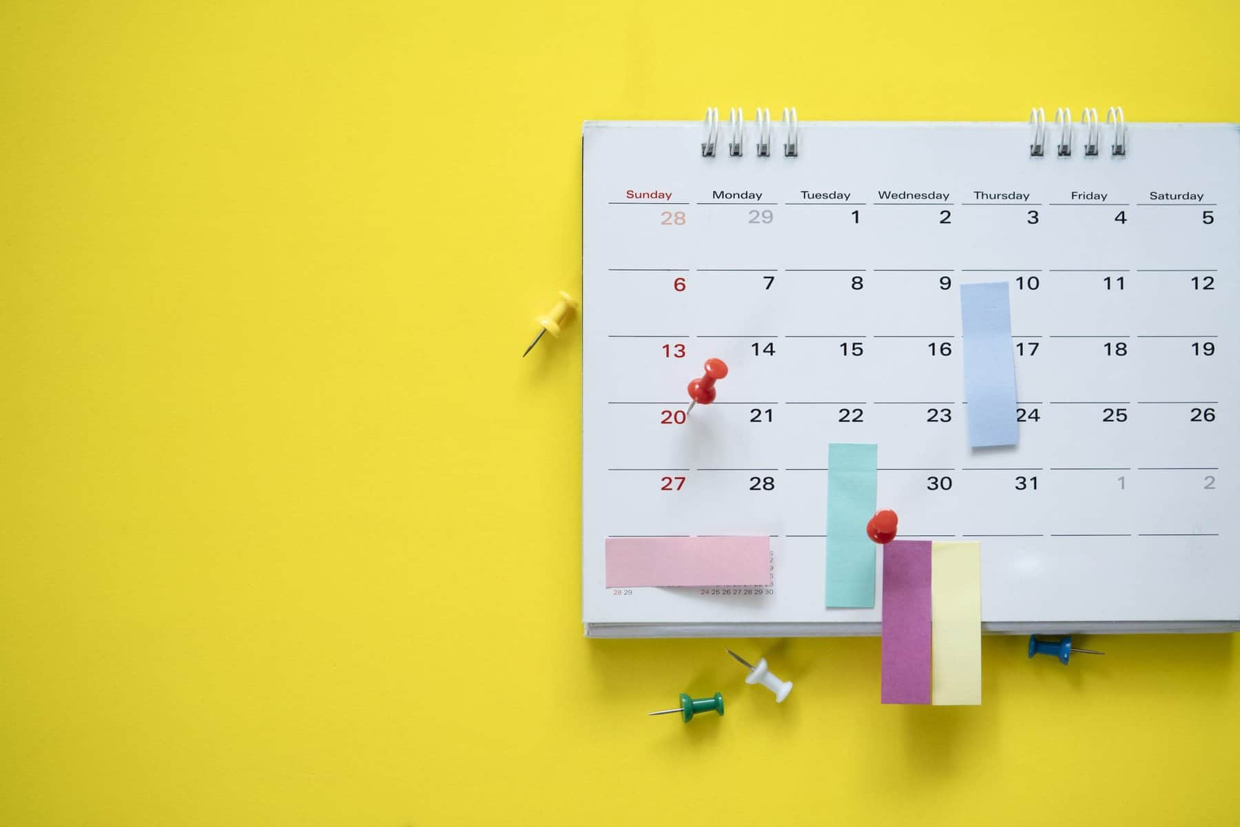 This is a Picture of a close up of calendar on the yellow background, planning for business meeting or travel planning concept for an article called What is scenario planning by Octopus Competitive Intelligence beat competitors, increase sales, solve problems, Competitor Analysis