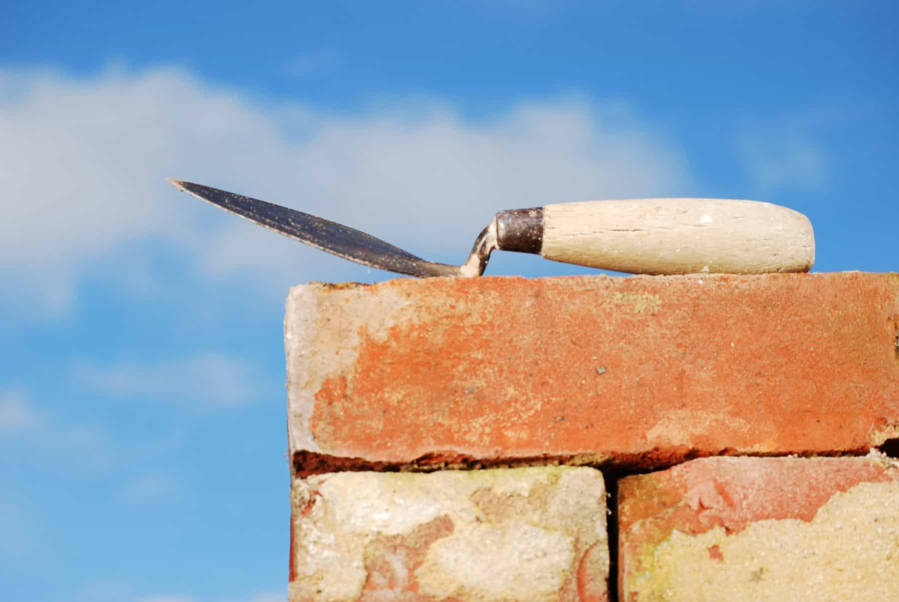 This is a picture of Trowel and Bricks for an article called Market Insight what's wrong with the property market? by Octopus Intelligence. We isolate your problems, reduce risk and uncertainty and deliver intelligence-led answers and innovative solutions. Dedicated to help you win.