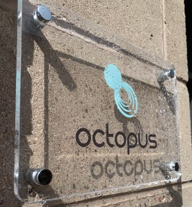 This is a picture of the outside of the octopus office by Octopus Competitive Intelligence, Due Diligence, Competitor Analysis, Market Analysis, Competitor Research and Strategic Business Development to beat your competitors, increase sales and reduce risk Contact us today. the plaque outside our offices contact