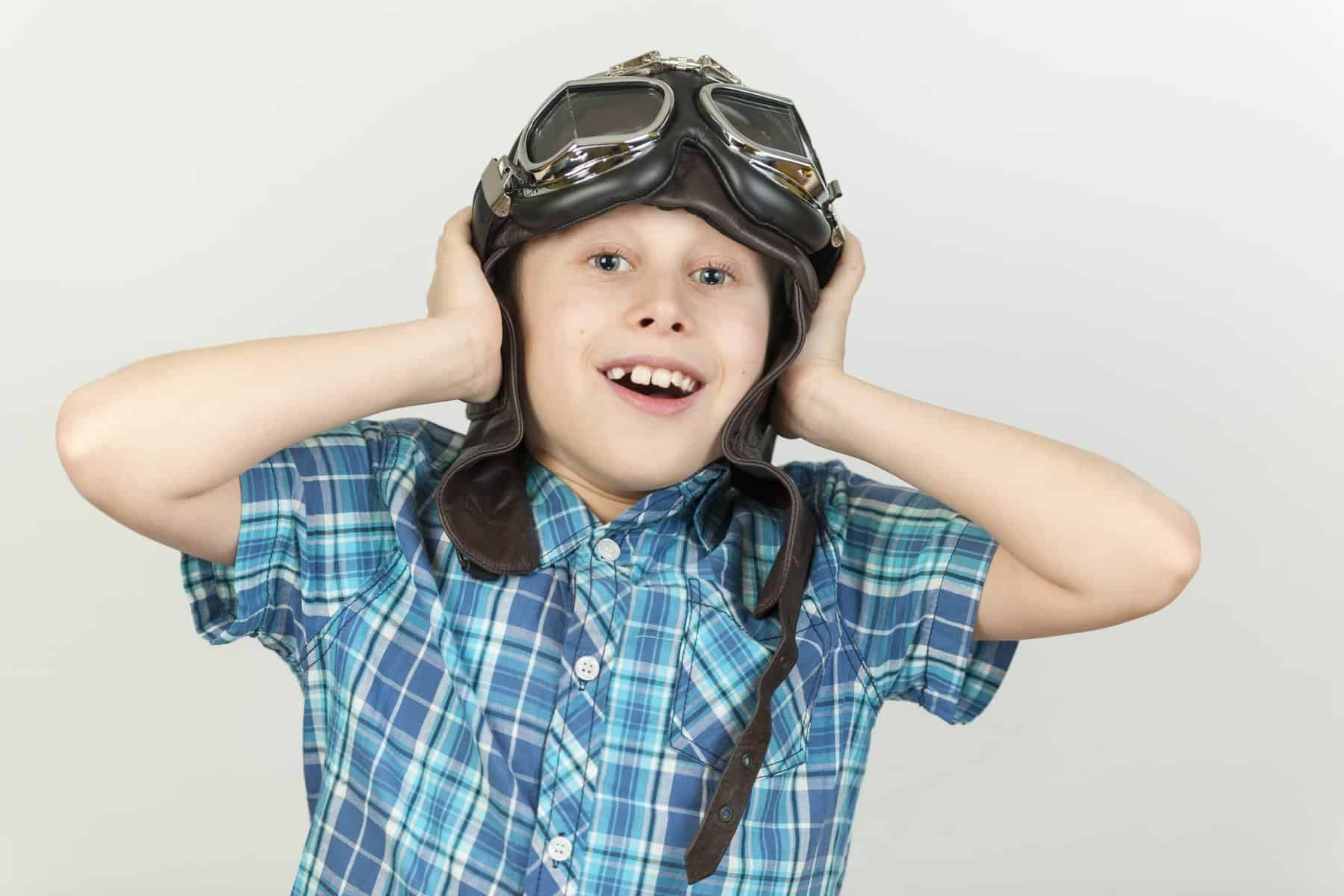This is a picture of a Boy with hands to ears and flying hat for an article by Octopus Intelligence client. We isolate your problems, reduce risk and uncertainty and deliver intelligence-led answers and innovative solutions. Dedicated to help you win.