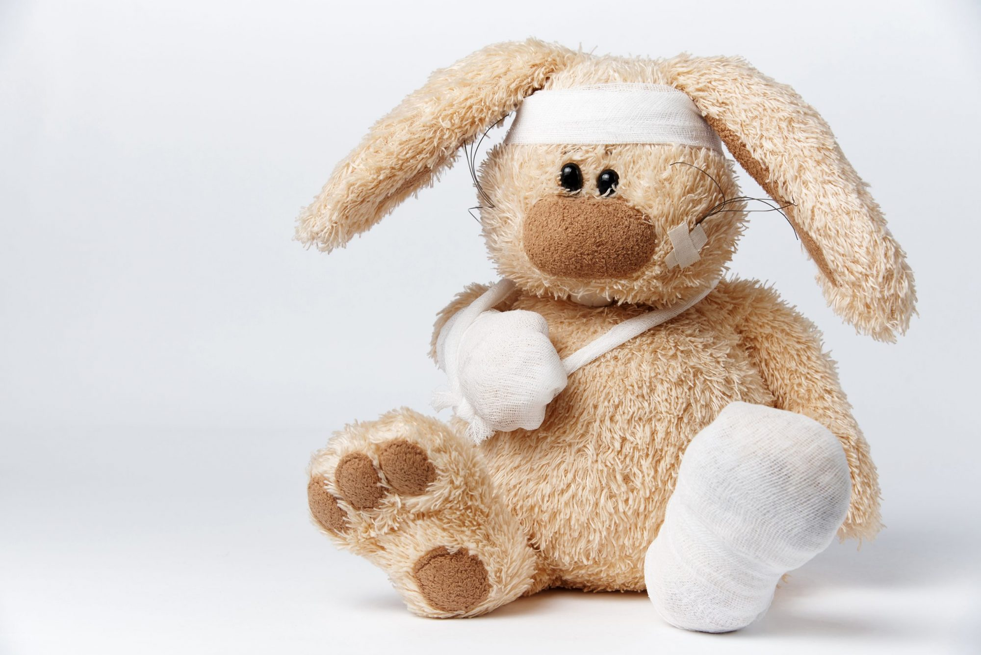 This is a picture of Cute sick bandaged hare on a white background for a post called What Competitive Intelligence mishaps can reduce the value of your operation by Octopus is a Competitive Intelligence Competitor Analysis & Strategy consulting firm focused on creating certainty, insight, competitive advantage & significant growth