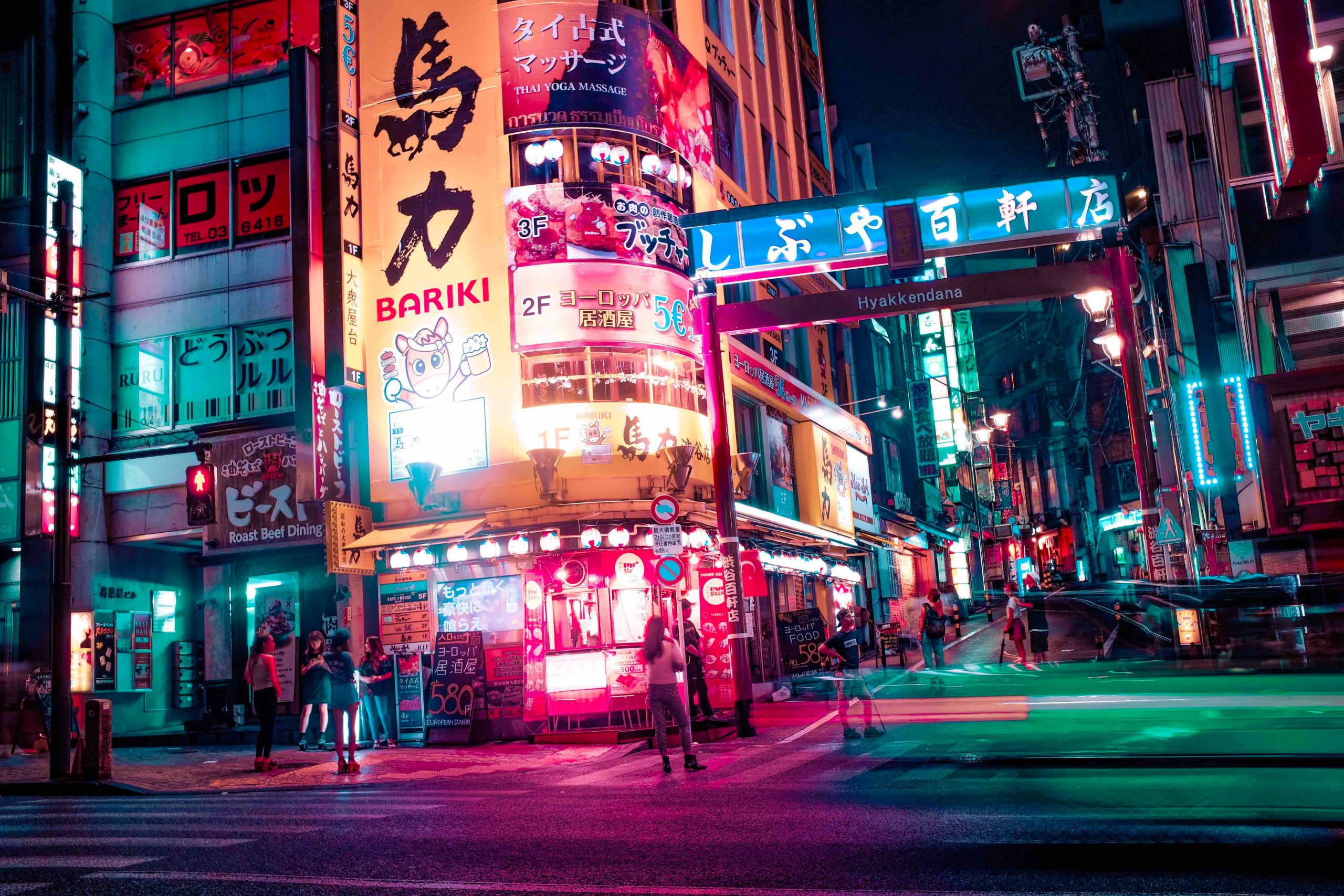 This is a picture a Tokyo night street scene a post called Competitive Intelligence expert Professor Fumiyuki Takahashi of the Japan University of Economics by Octopus is a Competitive Intelligence Competitor Analysis & Strategy consulting firm focused on creating certainty, insight, competitive advantage & significant growth
