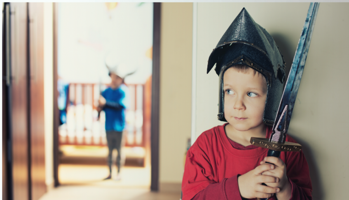 This is a picture of a child dressed as a knight hiding around a door for an article called Competitor Research Told Them They Were Not Ready For Battle by Octopus is a Competitive Intelligence Competitor Analysis & Strategy consulting firm focused on creating certainty, insight, competitive advantage & significant growth