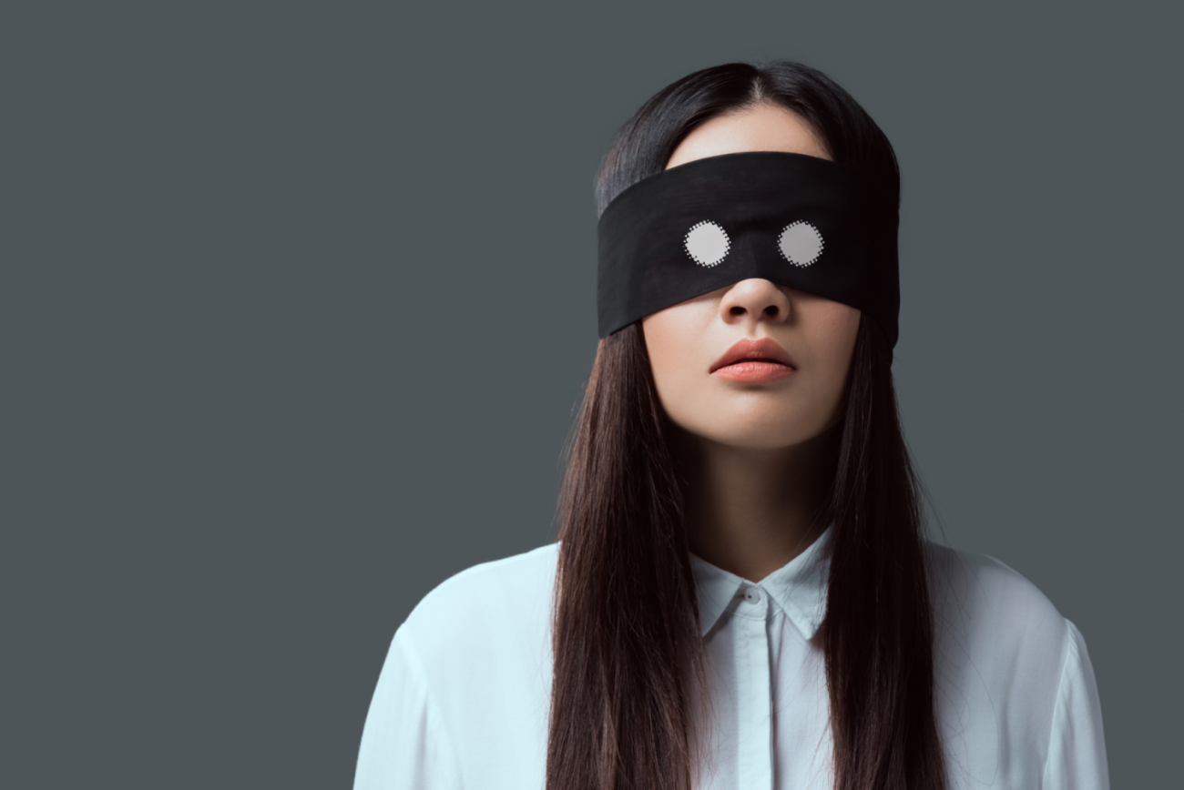This is a picture of a blindfolded women for an article called What is Competitive Intelligence in The Real World by Octopus is a Competitive Intelligence Competitor Analysis focused on creating certainty