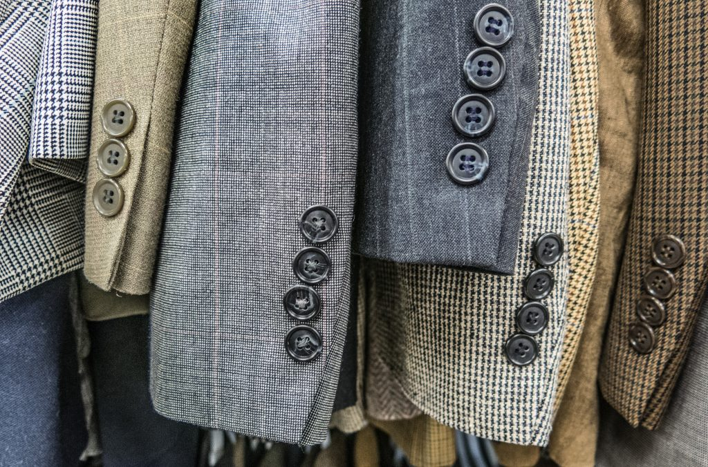 This is a picture a rail of mens jackets in a shop for a case study called Textile reshoring Market Analysis Case Study by Octopus is a Competitive Intelligence Competitor Analysis focused on creating certainty