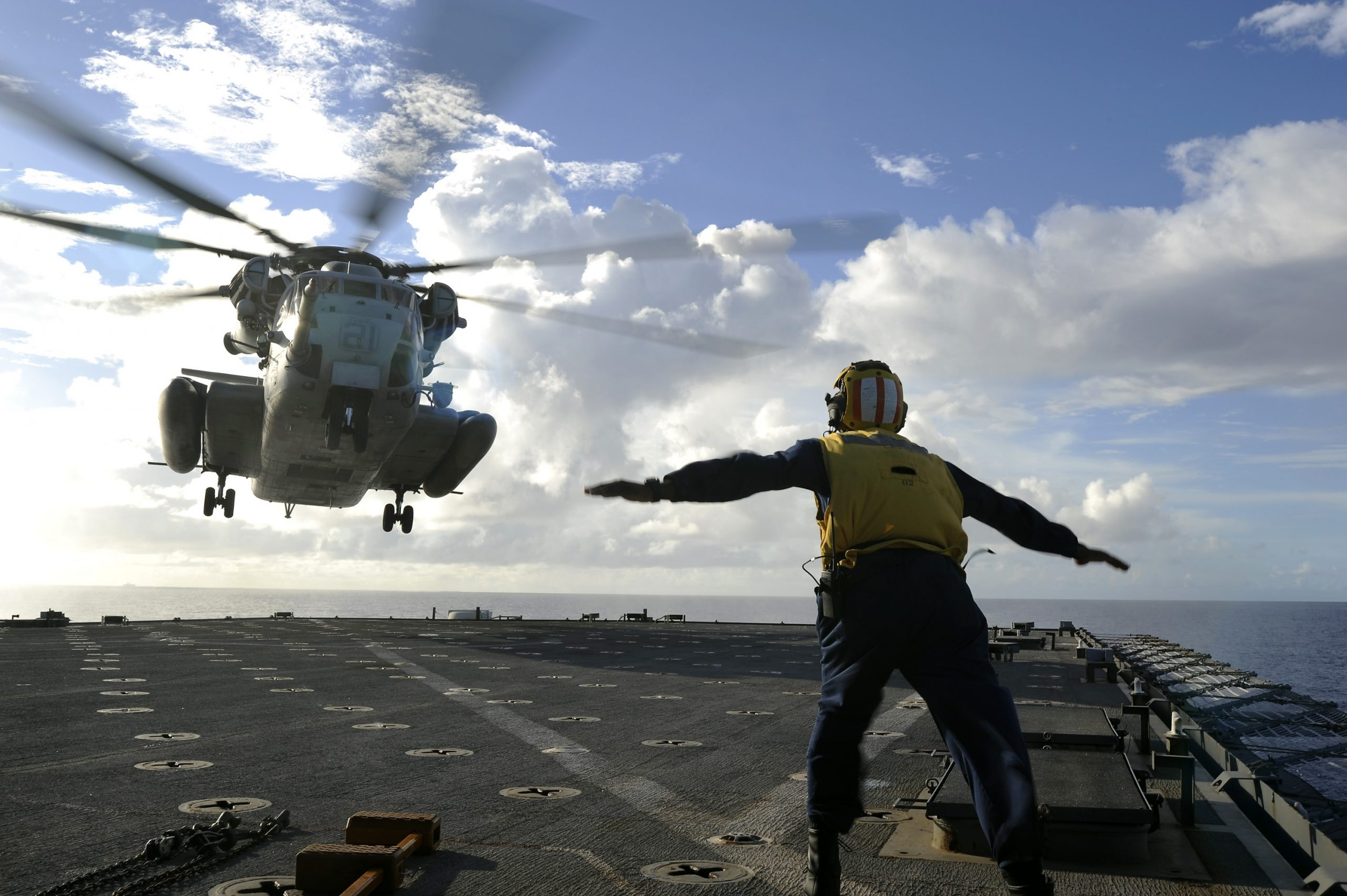 This is a picture of a military helicopter landing on an aircraft carrier for an article called Military communication Competitor Research case study by Octopus is a Competitive Intelligence Competitor Analysis focused on creating certainty
