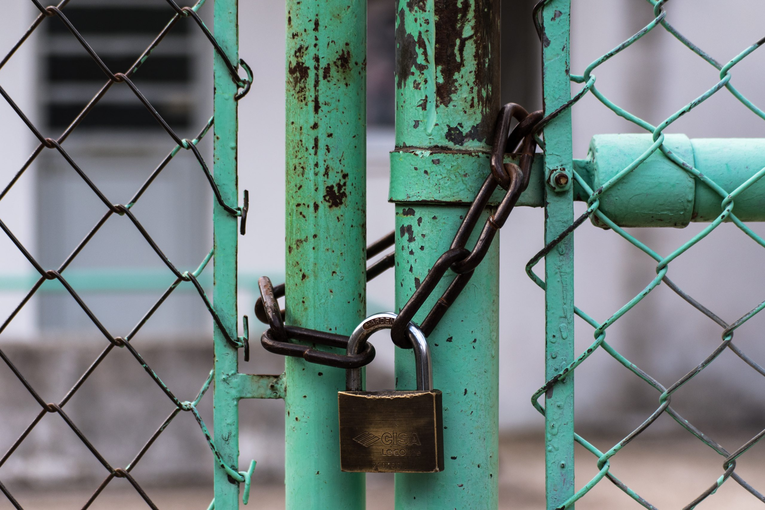 This is a picture of a pad locked green gate for an article called Security Product Competitor Analysis Case Study by Octopus is a Competitive Intelligence Competitor Analysis focused on creating certainty
