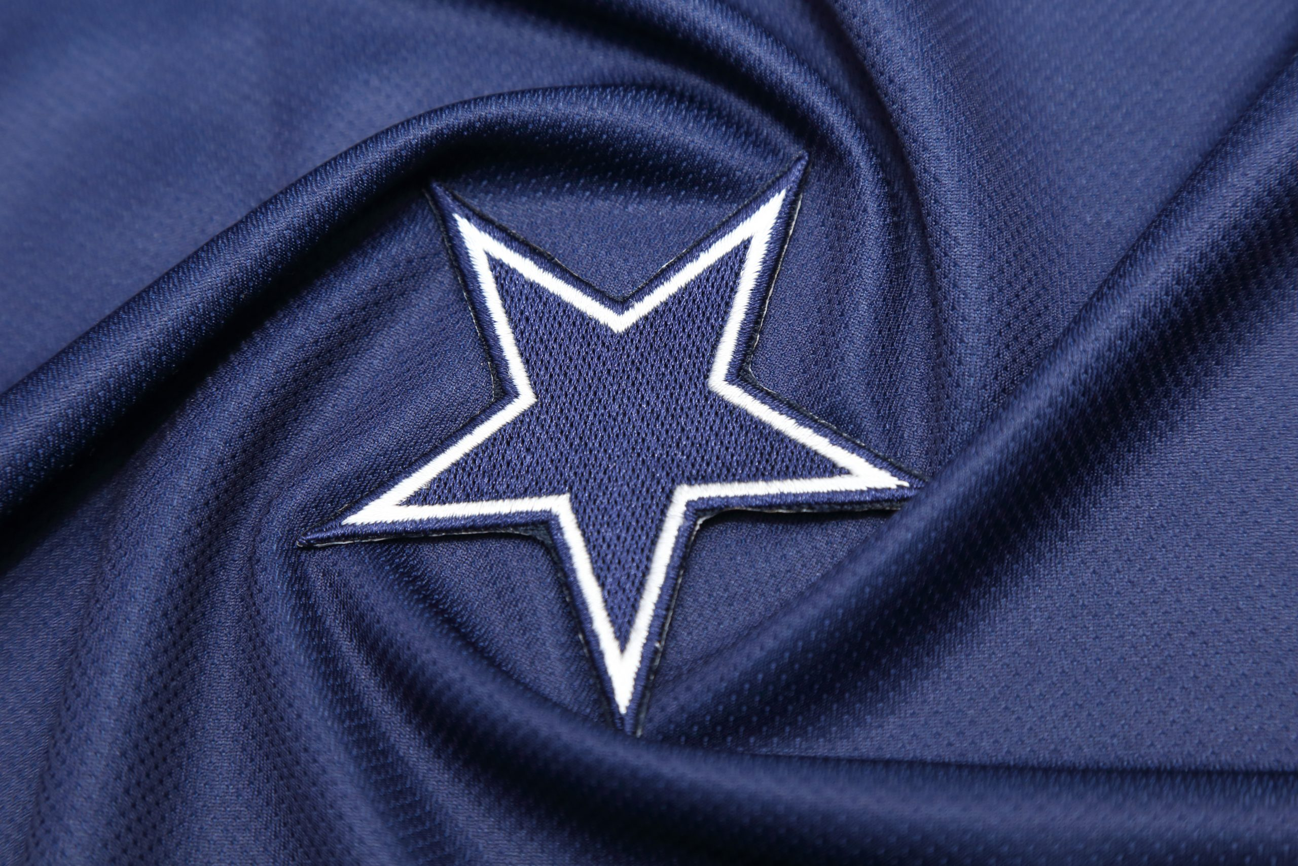 This is a picture of the Dallas Cowboys badge for an article called Competitive Intelligence Thoughts of Lone Star's Director of Competitive Intelligence, Laurie Young by Octopus is a Competitive Intelligence Competitor Analysis focused on creating certainty