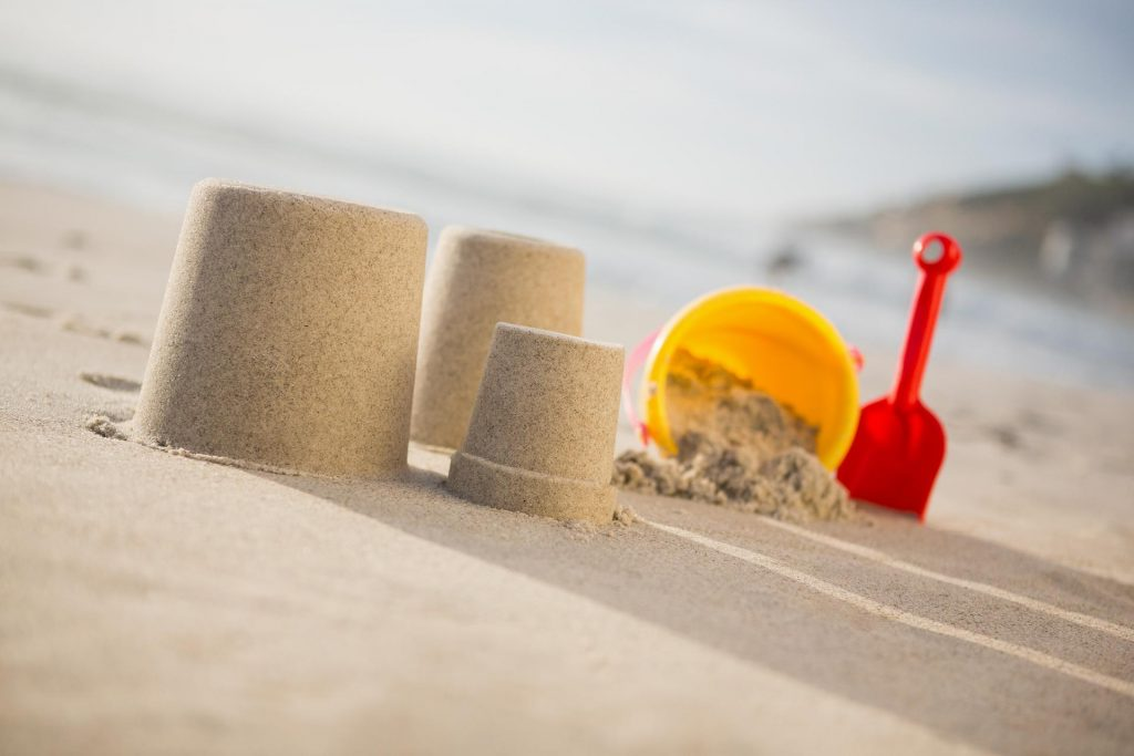 This is a picture of a sandcastle and bucket on a beach for an article called How Competitor Intelligence increased sales for a Facilities Management company by Octopus Competitive Intelligence Competitor Analysis focused on creating certainty
