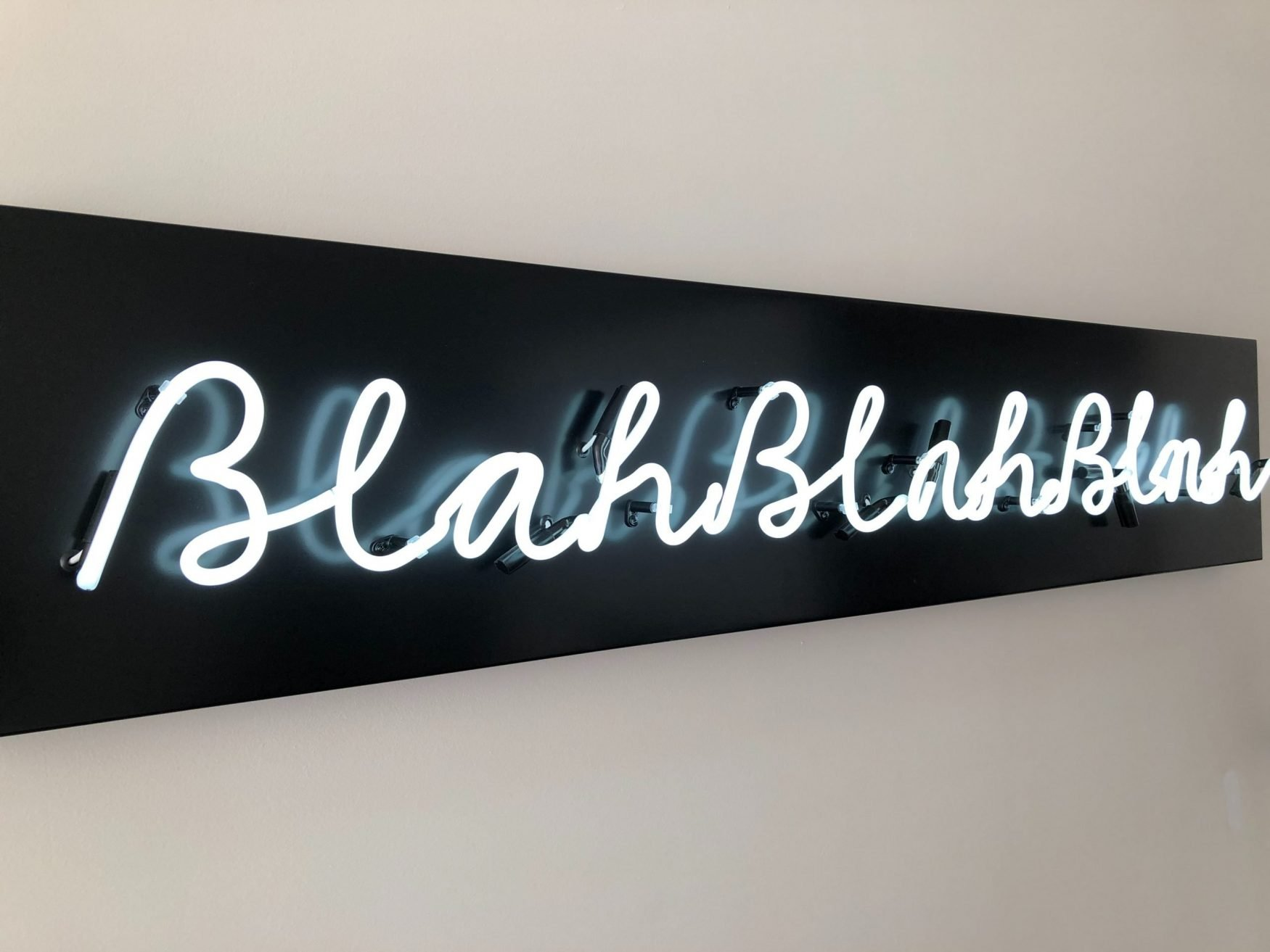 This is a picture of a neon light walk display saying Blah Blah Blah for an article called Is Competitive Intelligence without Key Assumption Analysis just lots of words by Octopus Competitive Intelligence Competitor Analysis focused on creating certainty